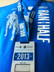 Finisher's shirt and medal for the 2013 BMO Vancouver Half Marathon